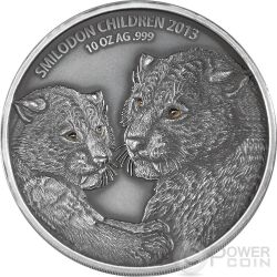 SMILODON CHILDREN Real Eye Saber Toothed Tiger 10 Oz Silver Coin 5000 Francs Burkina Faso 2013
