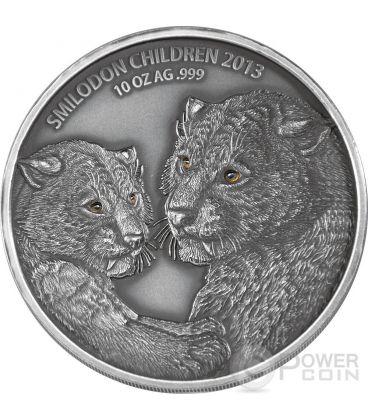 SMILODON CHILDREN Real Eye Saber Toothed Tiger 10 Oz Silver Coin 5000 Francs Burkina Faso 2013